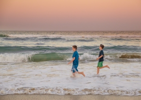Children running in the ocean Outer Banks OBX